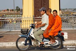 monks on a motorcycle