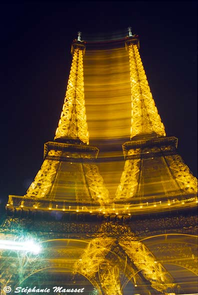 Night shot of twin Eiffel towers